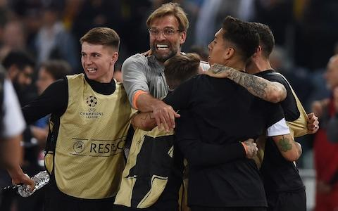 Jurgen Klopp celebrates with his players - Credit: GETTY IMAGES