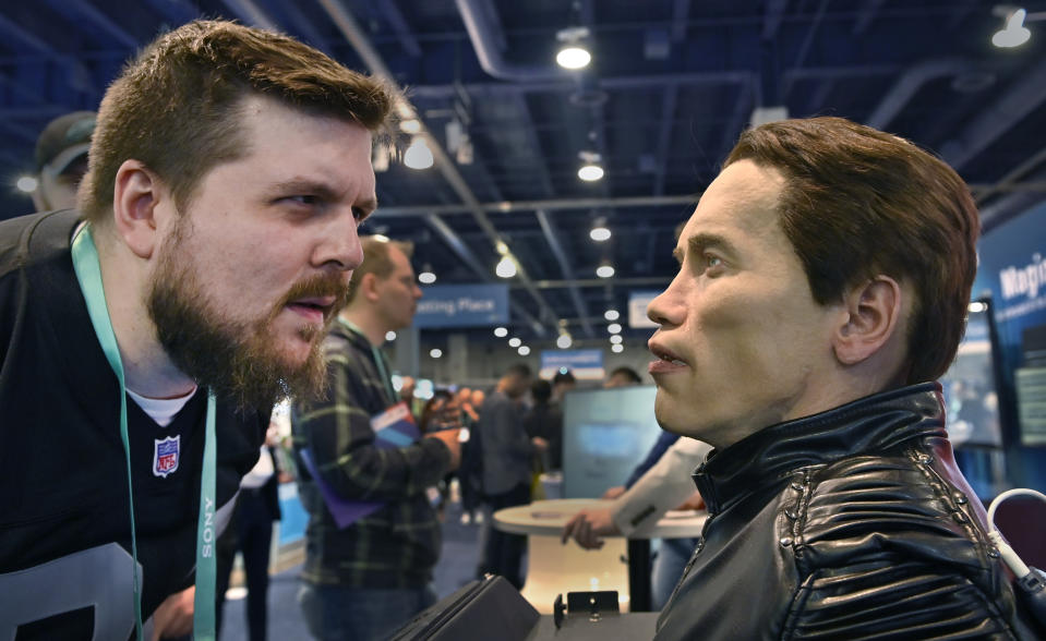 An attendee examines the Robo-C, an autonomous humanoid robot, at the Promobot booth during CES 2020. (Photo by David Becker/Getty Images)