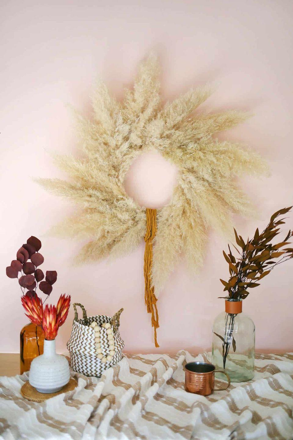 """<p>If you're more partial to wreaths, try this easy DIY. It's the perfect shade and texture for autumnal decor. </p><p><a class=""""link rapid-noclick-resp"""" href=""""https://abeautifulmess.com/pampas-grass-wreath-diy/"""" rel=""""nofollow noopener"""" target=""""_blank"""" data-ylk=""""slk:GET THE TUTORIAL"""">GET THE TUTORIAL</a></p>"""