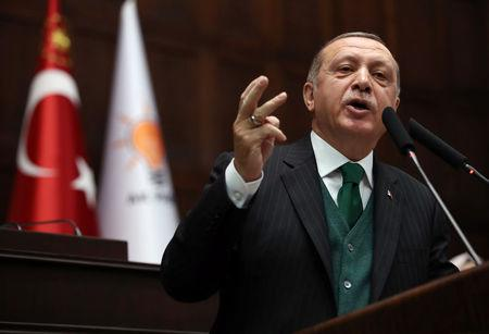Turkish President Erdogan addresses members of parliament of his ruling AKP during a meeting at the Parliament in Ankara