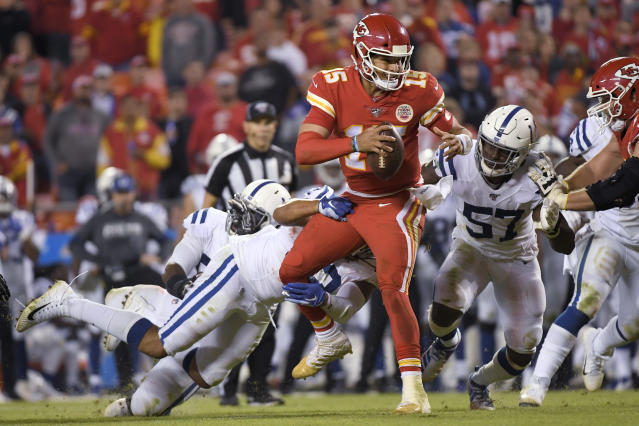 Kansas City Chiefs quarterback Patrick Mahomes (15) is tackled by Indianapolis Colts defensive end Jabaal Sheard (93) and defensive end Kemoko Turay (57) during the second half of an NFL football game in Kansas City, Mo., Sunday, Oct. 6, 2019. (AP Photo/Reed Hoffmann)