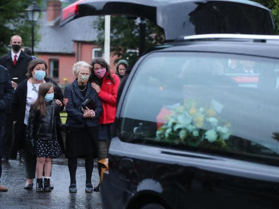 The coffin of John Hume is taken into St Eugene's Cathedral in Londonderry (Niall Carson/PA)