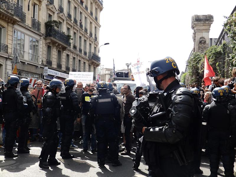 Gendarmes hold back protesters near Paris's Gare du Nord station: Pictures by: Lizzie Dearden