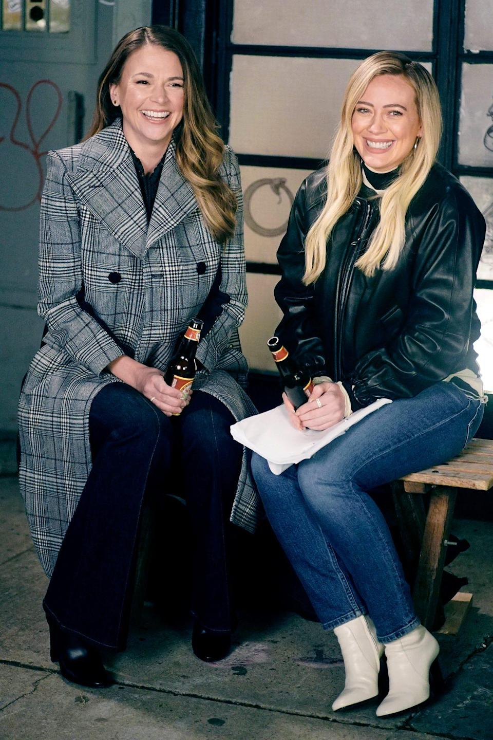 <p>Sutton Foster and Hilary Duff smile as they film scenes for the final season of <em>Younger </em>in N.Y.C. on Thursday. </p>