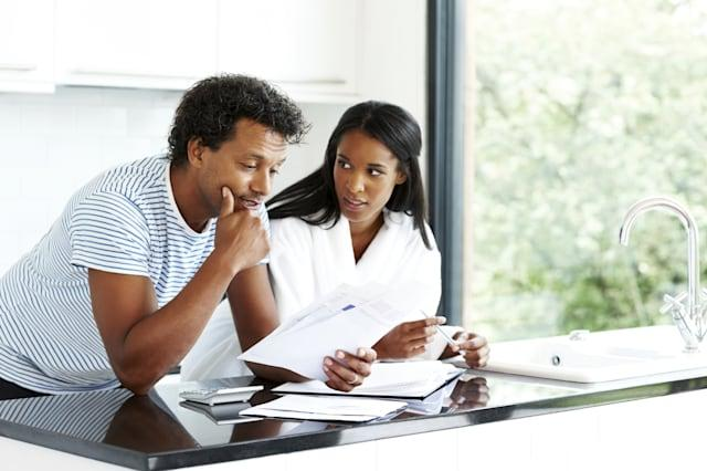 Worried couple working on personal finances