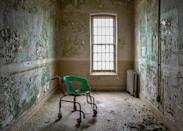 <p>In some images, chairs used to restrain chronically insane patients still stand. (Photo: Freaktography/Caters News) </p>