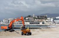 Construction machineries are seen in action on the beach of the Croisette in Cannes