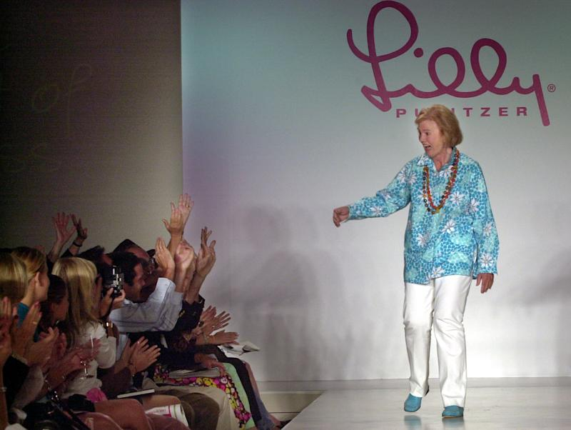 FILE - In this Saturday Sept. 21, 2002, file photo, Lilly Pulitzer reacts to cheers after the showing of her spring 2003 fashions in New York, 2002. P ulitzer, known for her tropical print dresses, died in Florida at 81 on Sunday, April, 7, 2013. ( (AP Photo/Bebeto Matthews)
