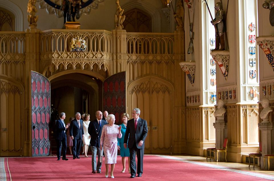 WINDSOR, UNITED KINGDOM - JUNE 15:  President George W. Bush and his wife, the First Lady Laura Bush meet with Queen Elizabeth II and Prince Philip, Duke of Edinburgh and walk through St George's Hall at Windsor Castle, on June 15, 2008 in Windsor, England.  (Photo by Tim Graham Photo Library via Getty Images)