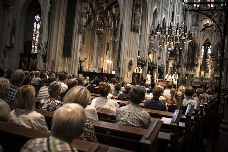 St Jan Cathedral is filled with people attending the evening vigil for those who were killed in Thursday's Malaysia Airlines Flight MH17 plane crash, in Den Bosch July 19, 2014. REUTERS/Mischa Rapmund