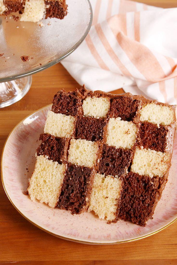 """<p>This is how chocolate and vanilla fans meet in the middle.</p><p>Get the recipe from <a href=""""https://www.delish.com/cooking/recipe-ideas/recipes/a52623/checkerboard-cake-recipe/"""" rel=""""nofollow noopener"""" target=""""_blank"""" data-ylk=""""slk:Delish"""" class=""""link rapid-noclick-resp"""">Delish</a>. </p>"""