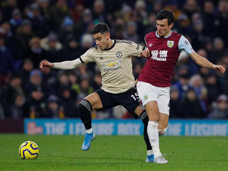 Manchester United's Andreas Pereira in action with Burnley's Jack Cork: REUTERS