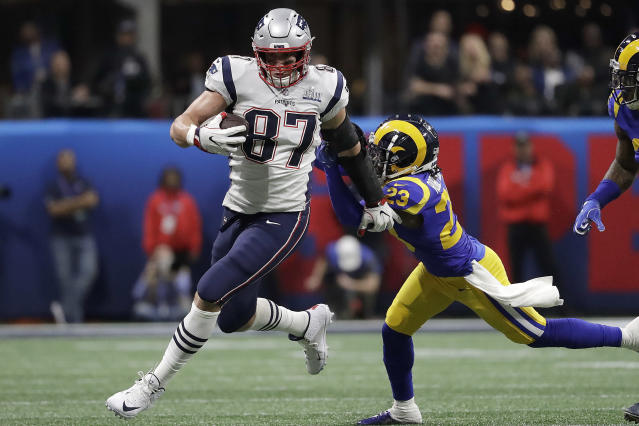 """FILE - In this Feb. 3, 2019, file photo, New England Patriots' Rob Gronkowski (87) runs against Los Angeles Rams' Nickell Robey-Coleman (23) during the first half of the NFL Super Bowl 53 football game in Atlanta. Gronkowski says he is retiring from the NFL after nine seasons. Gronkowski announced his decision via a post on Instagram Sunday, March 24, 2019, saying that a few months shy of this 30th birthday """"its time to move forward and move forward with a big smile."""" (AP Photo/Jeff Roberson, File)"""