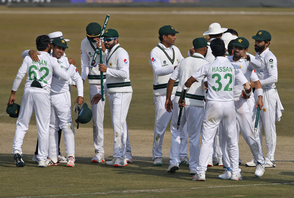 Pakistani players congratulate each others after winning the second cricket test match between Pakistan and South Africa at the Pindi Stadium in Rawalpindi, Pakistan, Monday, Feb. 8, 2021. (AP Photo/Anjum Naveed)