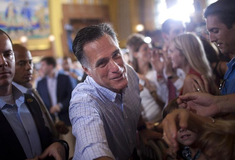 Republican presidential candidate, former Massachusetts Gov. Mitt Romney shakes hands during a campaign rally, Saturday, Sept. 1, 2012, in Cincinnati, Ohio.  (AP Photo/Evan Vucci)