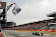 On the charge: Lewis Hamilton took the German GP after a brilliant drive in the rain after qualifying 14th