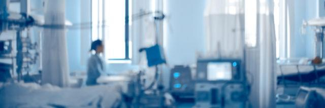photo of intensive care unit of modern hospital, unfocused background.