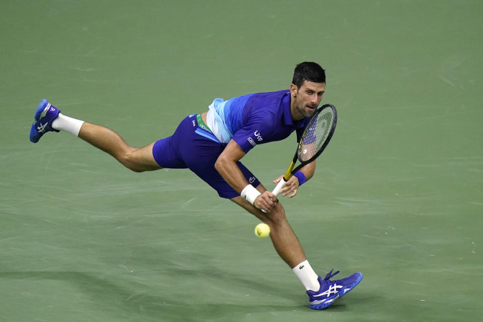 Novak Djokovic, of Serbia, watches a return to Matteo Berrettini, of Italy, during the quarterfinals of the U.S. Open tennis tournament Wednesday, Sept. 8, 2021, in New York. (AP Photo/Frank Franklin II)