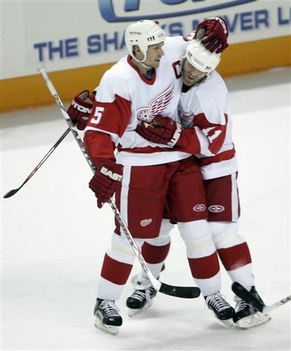 Detroit Red Wings defenseman Nicklas Lidstrom (5), of Sweden, is congratulated by right wing Daniel Cleary (11) after scoring against the San Jose Sharks in the first period of Game 3 of their second-round NHL hockey playoff series in San Jose, Calif., Monday, April 30, 2007. (AP Photo/Paul Sakuma)
