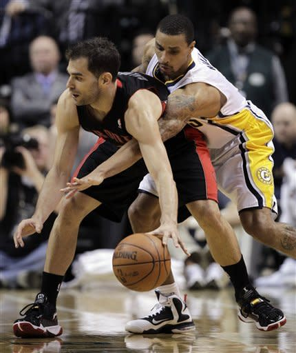 Indiana Pacers guard George Hill, rights, reaches around Toronto Raptors guard Jose Calderon in the second half of an NBA basketball game in Indianapolis, Monday, April 9, 2012. The Pacers defeated the Raptors 103-98. (AP Photo/Michael Conroy)