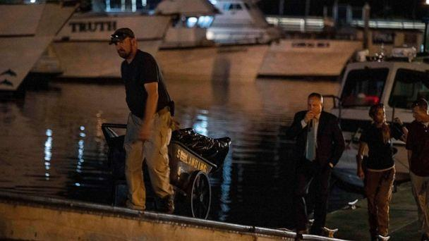 PHOTO: Authorities cart away evidence taken from the scuba boat Conception in Santa Barbara Harbor at the end of their second day searching for the remaining divers who were missing on Sept. 3, 2019, in Santa Barbara, Calif. (Christian Monterrosa/AP)