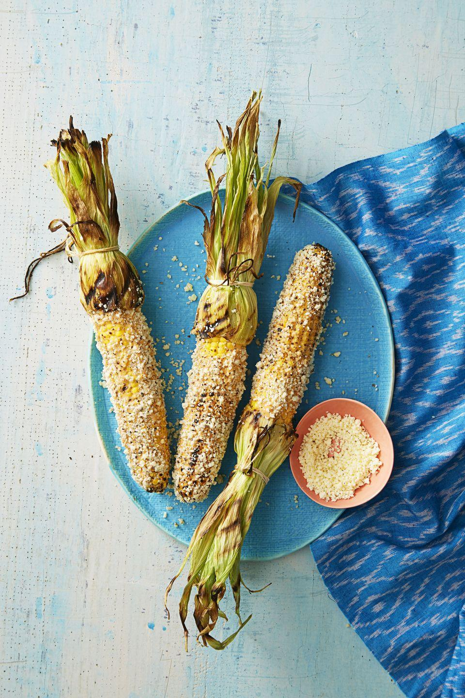 """<p>Grilled corn gets even better with zesty, spicy, and smoky toppings. Oh, and plenty of crumbled Cotija cheese.</p><p><em><a href=""""https://www.goodhousekeeping.com/food-recipes/a38825/mexican-grilled-corn-recipe/"""" rel=""""nofollow noopener"""" target=""""_blank"""" data-ylk=""""slk:Get the recipe for Mexican Grilled Corn »"""" class=""""link rapid-noclick-resp"""">Get the recipe for Mexican Grilled Corn »</a></em> </p>"""