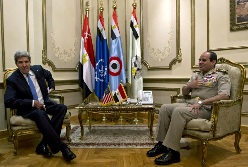 U.S. Secretary of State John Kerry, meets with Gen. Abdel Fattah el-Sissi, right, in Cairo, Egypt, Sunday, Nov. 3, 2013. Kerry is in Cairo pressing for reforms during the highest-level American visit to Egypt since the ouster of the country's first democratically elected president. The Egyptian military's removal of Mohammed Morsi in July led the U.S. to suspend hundreds of millions of dollars in aid. This is the first stop in an 11-day trip that will take Kerry to the Mideast and Europe. (AP Photo/Jason Reed, Pool)