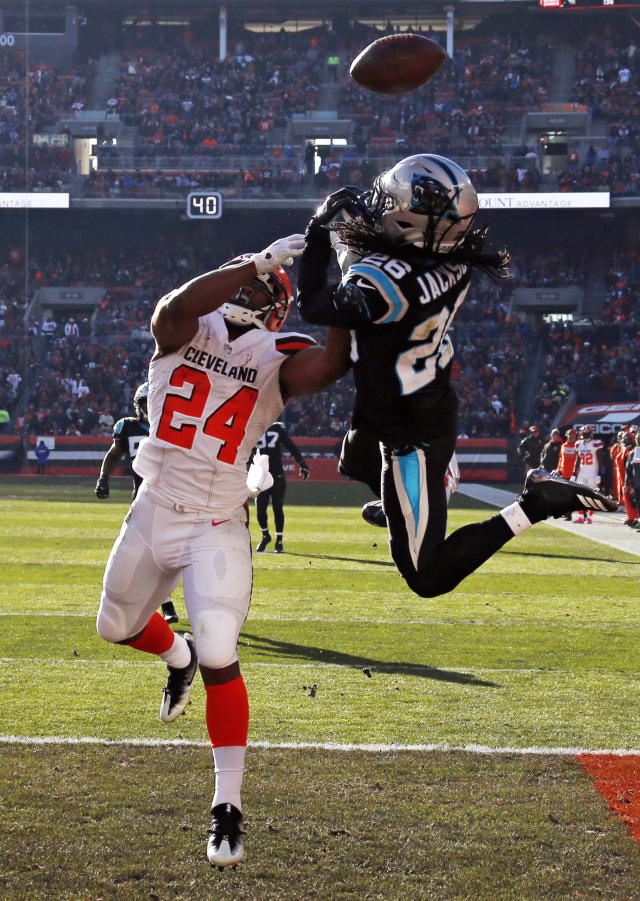 Carolina Panthers cornerback Donte Jackson (26) breaks up a pass intended for Cleveland Browns running back Nick Chubb (24) in the end zone during the first half of an NFL football game, Sunday, Dec. 9, 2018, in Cleveland. (AP Photo/Ron Schwane)