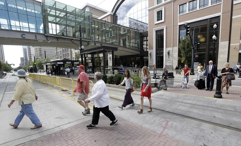 """People walk across the street in front of the City Creek shopping center, Tuesday, Sept. 24, 2013, in Salt Lake City, Utah. Jack Harry Stiles, a Utah man accused of plotting a deadly attack on a luxe outdoor shopping center in the heart of Salt Lake City this week told investigators he planned to """"just randomly shoot and kill people."""" (AP Photo/Rick Bowmer)"""