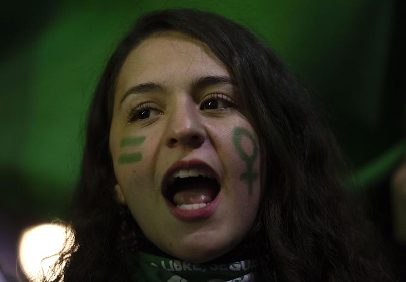 A demonstrator takes part in a march for a legal, safe and free abortion in Santiago, on 25 July 2018: Getty