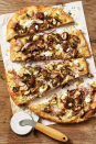 "<p>The mushrooms and Brussels sprouts are tossed in balsamic vinegar before topping off this restaurant-worthy pie. Rich and creamy fontina cheese brings even more flavor.</p><p><em><a href=""https://www.goodhousekeeping.com/food-recipes/a34386715/mushroom-brussels-sprouts-pizza-recipe/"" rel=""nofollow noopener"" target=""_blank"" data-ylk=""slk:Get the recipe for Mushroom and Brussels Sprouts Pizza »"" class=""link rapid-noclick-resp"">Get the recipe for Mushroom and Brussels Sprouts Pizza » </a></em></p>"