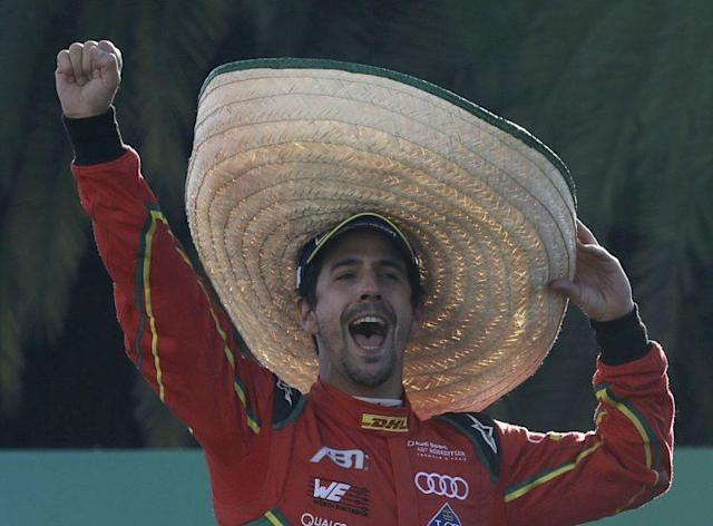 ABT Schaeffler Audi Sport team driver Lucas Di Grassi wearing a Mexican Charro hat celebrates his victory in the Formula E Mexico City ePrix auto race, in Mexico City, Saturday, April 1, 2017. Di Grassi won the race, Techeetah team driver Jean Eric Vergne was second and DS Virgin Racing driver Sam Bird was third. (AP Photo/Marco Ugarte)