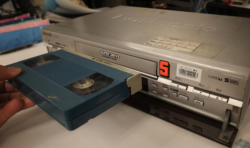 The world's last videocassette recorder is set to roll off the factory line as a Japanese manufacturer ends production of the once booming home-theatre technology (AFP Photo/Kazuhiro Nogi)