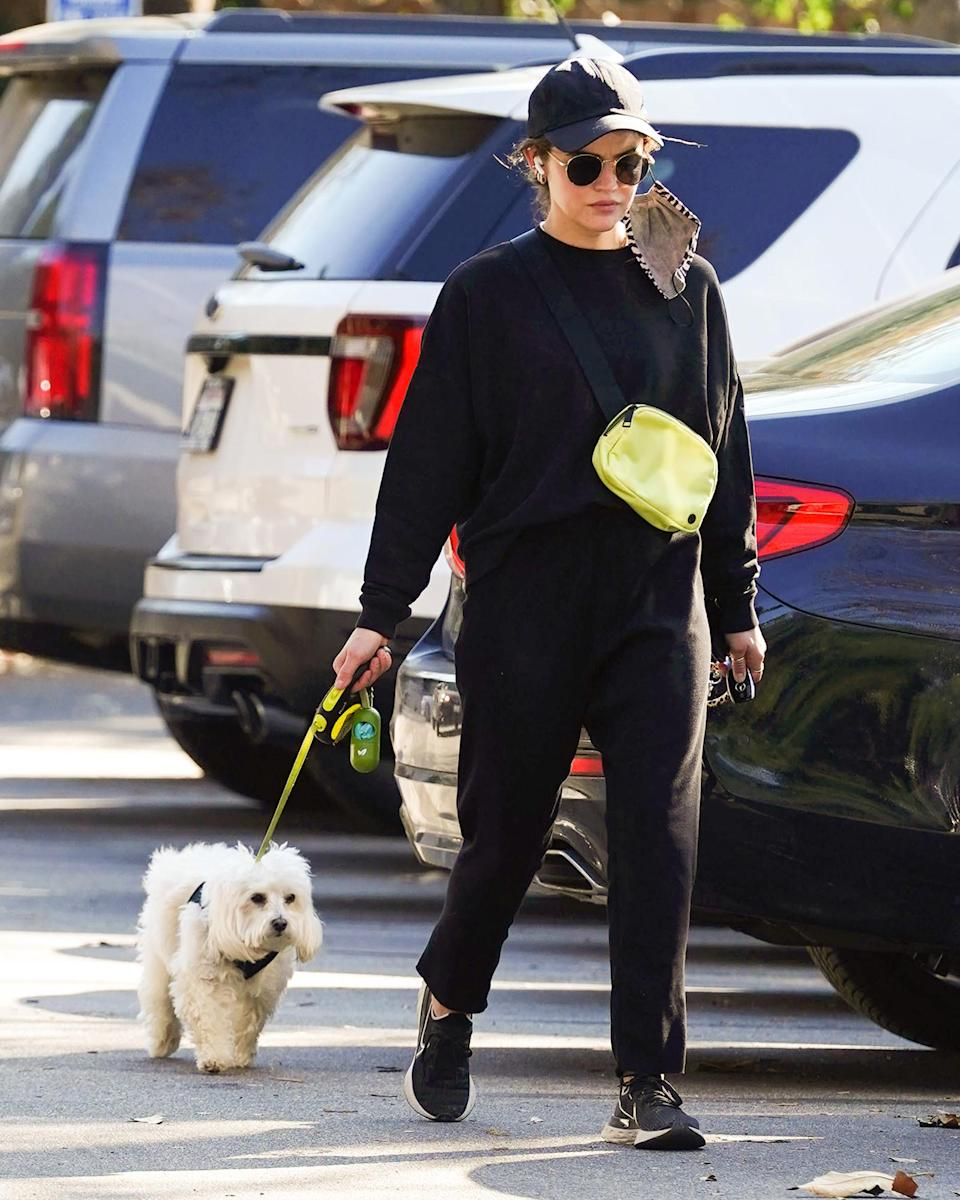 <p>Lucy Hale takes her pup for a walk in Los Angeles on Thursday.</p>