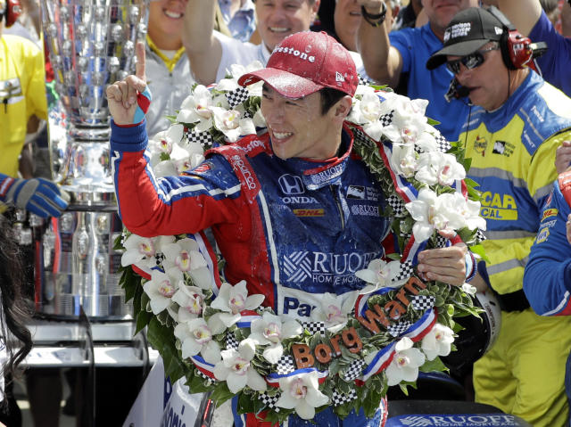 FILE - In this May 28, 2017, file photo, Takuma Sato, of Japan, celebrates winning the Indianapolis 500 auto race at Indianapolis Motor Speedway in Indianapolis. The billboards went up all over Japan when Takuma Sato held off Helio Castroneves in a dramatic Indy 500, becoming the first driver from his nation to win one of motorsport's pinnacle events. Now, after a switch from Andretti Autosport to Rahal Letterman Lanigan Racing, he's back to defend his title this weekend.(AP Photo/Darron Cummings, File)