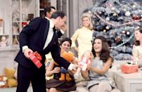 <p>On the set of <em>The Dean Martin Show Christmas Special</em> in December of 1967, Frank Sinatra gives gifts to Tina Sinatra and Deana Martin.</p>