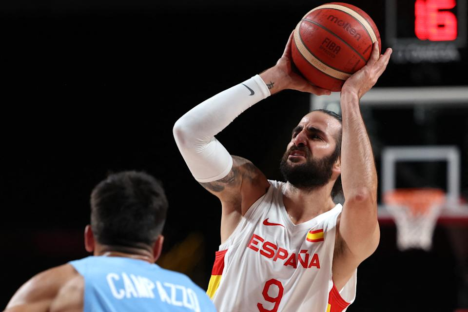 Spain's Ricky Rubio (R) shoots the ball as Argentina's Facundo Campazzo watches in the men's preliminary round group C basketball match between Spain and Argentina during the Tokyo 2020 Olympic Games at the Saitama Super Arena in Saitama on July 29, 2021. (Photo by Thomas COEX / AFP) (Photo by THOMAS COEX/AFP via Getty Images)