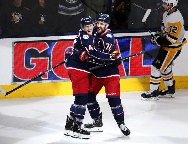 Columbus Blue Jackets forward Gustav Nyquist, left, of Sweden, celebrates his third goal of an NHL hockey game against the Pittsburgh Penguins with teammate forward Nick Foligno during the third period in Columbus, Ohio, Friday, Nov. 29, 2019. (AP Photo/Paul Vernon)