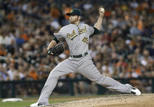 Oakland Athletics' Brett Anderson throws against the Detroit Tigers in the seventh inning of a baseball game in Detroit, Wednesday, Aug. 28, 2013. (AP Photo/Paul Sancya)