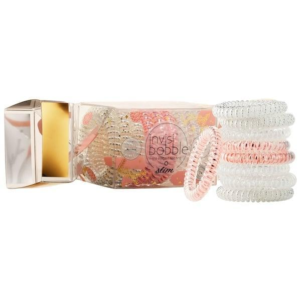 """<p>This <span>Invisibobble That's Crackin' Slim Trio</span> ($18) will keep flyaways at bay for any barre buddies or Pilates pals. (PS: We have a <a href=""""https://www.popsugar.com/beauty/How-Mend-Stretched-Out-Invisibobble-45007237"""" class=""""link rapid-noclick-resp"""" rel=""""nofollow noopener"""" target=""""_blank"""" data-ylk=""""slk:great tip"""">great tip</a> to help these hair rings keep their shape.)</p>"""