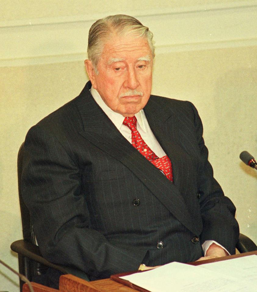 Chile's former Army Commander in Chief Gen. Augusto Pinochet, attends a session at the Chilean Senate, as he was sworn in as Senator for life in Valparaiso, Wednesday, March 11, 1998. Pinochet assumed the Senate seat that he is entitled to in the constitution written by his regime, despite protests outside the Congress and displays by his new colleagues inside of photos of people who disappeared during his 17-year dictatorship. (AP Photo/Eduardo Di Baia)