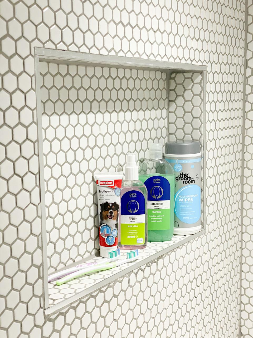 The impressive space has a recessed shelf for all their pooch pamper products. (@homestuffonly and Drench)