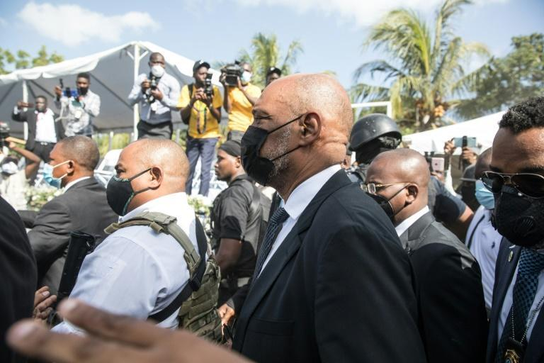 Haiti's Prime Minister Ariel Henry (C), seen here attending the funeral of slain President Jovenel Moïse on July 23, 2021, in Cap-Haitien, Haiti, fired a prosecutor who accused him of links to the killing (AFP/Valerie Baeriswyl)