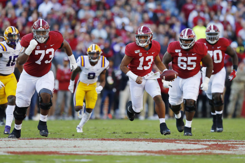 Tua Tagovailoa (13) was effective for Alabama against LSU despite not being 100 percent. (Photo by Kevin C. Cox/Getty Images)