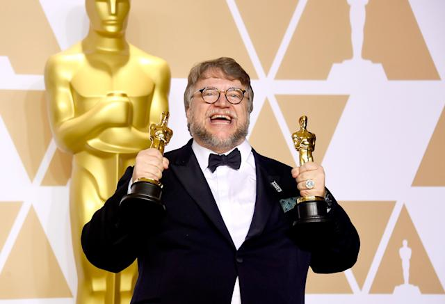 Guillermo del Toro holds his trophies for Best Picture and Best Director.