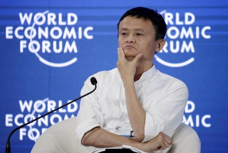 Chairman and chief executive of Alibaba Group Ma reacts during a session at the WEF in Dalian
