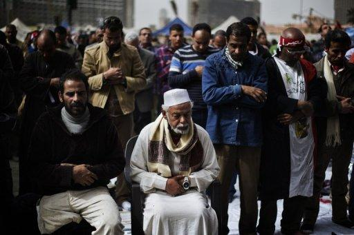 <p>Egyptian anti-government protestors perform Friday prayers ahead of a demonstration against Egypt's President in Cairo's landmark Tahrir square on February 22, 2013. Anger in the country has been fuelled not just by political divisons but by a crippling economic crisis.</p>