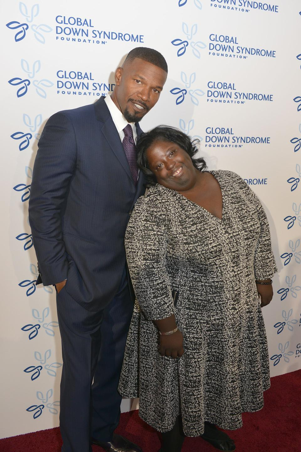 """DENVER, CO - NOVEMBER 12: Celebrity Jamie Foxx with his sister DeOndra Dixon on the red carpet at the at Global Down Syndrome Foundation's 2016 """"Be Beautiful Be Yourself"""" at the Hyatt Regency Denver at the Colorado Convention Center on November 12, 2016 in Denver, Colorado.  (Photo by Thomas Cooper/Getty Images,)"""