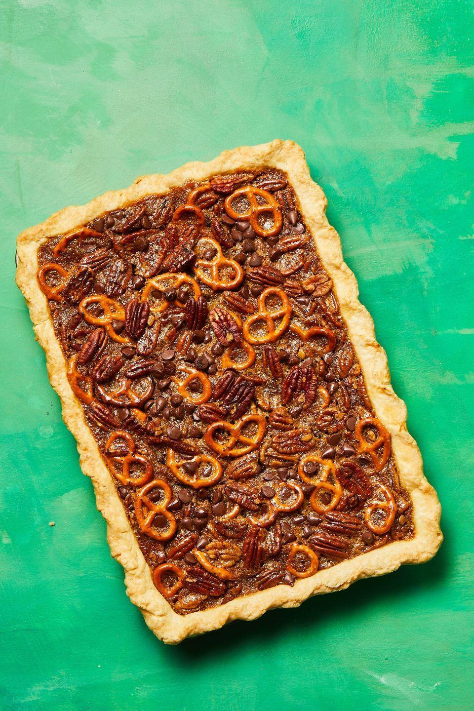 "<p>Salty pretzels, sweet chocolate chips, and rich pecans make a mouthwatering combo that's even better with a splash of bourbon stirred into the batter.</p><p><strong><em><a href=""https://www.womansday.com/food-recipes/a34145910/pretzel-chocolate-pecan-pie-bars-recipe/"" rel=""nofollow noopener"" target=""_blank"" data-ylk=""slk:Get the Pretzel-Chocolate Pecan Pie Bars recipe."" class=""link rapid-noclick-resp"">Get the Pretzel-Chocolate Pecan Pie Bars recipe. </a></em></strong></p>"
