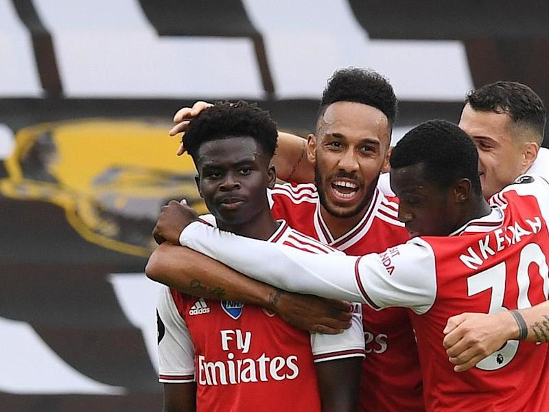 Arsenal celebrate after Saka scores: Getty